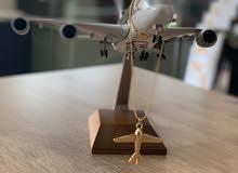 قلادة على شكل طائرة