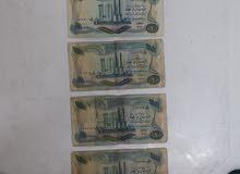 عمله عليها صورة صدام حسين العراقيه فئة 1 دينار