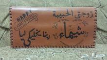 محفظة جلد طبيعي هاند ميد محفور عليها الاسم