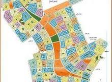 ارض للبيع بيت الوطن الحى الثانى على فاصل وميدان 702 متر مدفوع بالقسط الاول 96 الف دولار