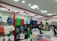 للبيع محل ملابس أطفال بكل ما فيه
