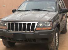 جيب النمر رباعي موديل jeep grand Cherokee 2002