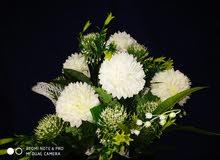 زهور صناعية راقيه لكافة الديكورات المنزلية والمكتبية