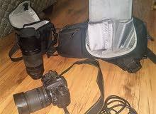 كاميرا نيكون D7000 SLR-D مع شاحن وعدسة وحقيبة للبيع + Zoom