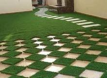 تنسيق الحدائق وتركيب العشب الطبيعي و الصناعي