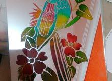 مرايا مرسوم عليه و مزخرفة بالوان الزجاج تستخدم للديكور