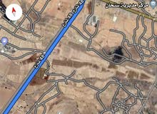 ارض علئ شارع 16  3 لبن حاليه الارض قريب من مستشفى 48 علئ شارع 40