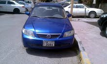 Mazda 323 car for sale 2003 in Hawally city