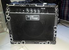 electric guitar with a new amp in good condition
