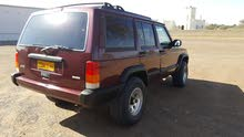 For sale 2000 Red Cherokee