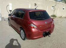 urgent sale Nissan thida 2009 gcc 1.8 lady use one year mulkiya very new conditi