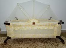 سرير بيبي هـزاز أصفر