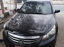 للبيع سيارة هوندا أكورد موديل 2012 لون أسود