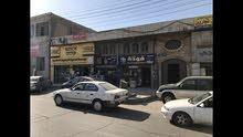 محل تجاري موقع مميز على شارع ماركا الرئيسي مع سده
