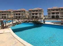 شاليه بالساحل الشمالى 3 غرف مساحته 115م على البحر مباشرة داخل قرية متكاملة الخدمات قسط على10