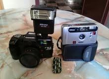 كامرتين الثمانينيات والتسعينات Nikon و canomatic  في حالة جيدة تعملان