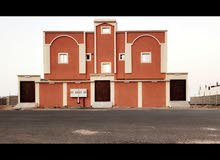 عمارة للبيع حي البوادي سبع شقق و ملحق مؤجرة بالكامل