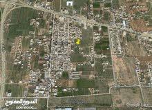 أرض سكنية للبيع بمنطقة الكايخ أمام مدخل مطار طرابلس الدولي