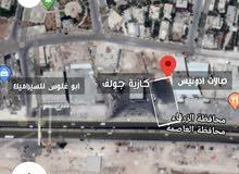 ارض للبيع اتوستراد عمان الزرقاء