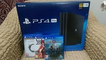 PS4 pro with two controllers للبيع