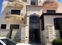 شقة مميزة شبه ارضي 170 م خلف المدارس العالميه ط المطار