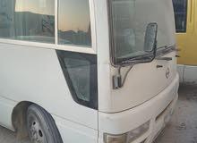 باص Nissan civilian موديل 2009 بترول 26 راكب للبيع في مدينة جبل علي