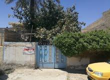 بيت بناء قديم للبيع في منطقة البلديات الجهة المقابلة للمصرف (شارع جامع الرحمن)