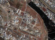 ارض للبيع مساحة 15 دونم ام الكندم بجانب مدارس الشويفات بواجهة عريضة جدا