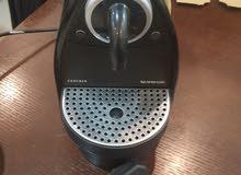 ماكينة تحضير قهوة  ماركة نسبرسو Nesprsso مع فنجانين هدية