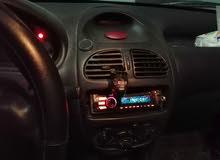 بيجو 206 موديل 2001 جير عادي للبيع أو البدل على سياره اتوماتيك