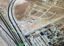 قطعة ارض في اعلى قمه بالطنيب بجانب جامعة الاسراء