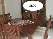 buffet and table with 8 chairs