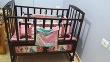 سرير أطفال مستخدم بحالة جيدة