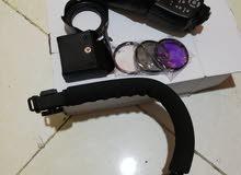 إكسسوارات كاميرا للبيع ( Speed light , Hood , C- Shaped Handheld Camera Staillizer , Filters 3 pcs )