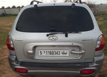 سيارة مستعملة للبيع نوع هونداي سنتافي اللون الرصاصي ماشيه 215كيلو متر اتوماتيك د
