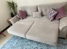 sofa bed , with big storage boxes and pillows
