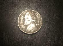 5 cent  in god we trust)عمله امريكيه نادره سنه الصنع 1964 مكتوب عليها