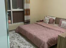 للايجار شقة مفروشة بالشارقة التعاون غرفة وصالة فرش ممتاز
