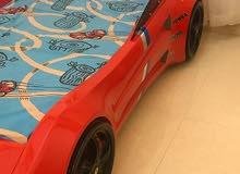 سرير للاطفال على شكل سيارة فابل لتفاوض