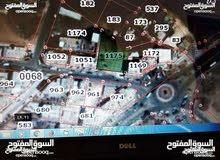 قطعة أرض تجاري 1160م -على يمين دوار المحبه