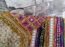 ملابس عمانية وفستان عمانية