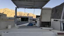قارب 28 قدم برموكه صنع في الامارات قارب سياحي القرب بدون محرك 99006614 الضمان القارب والصبغ
