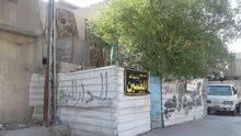 دار للبيع مدينه الصدر قطاع 33 على شارع العام