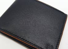 men wallet and belt leather , women's handbags and clutches leather