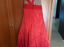 فستان مناسبات احمر. A beautiful red prom dress