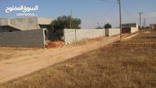 قطعة ارض مساحتها 500 متر بمدينه العزيزيه في حي سكني