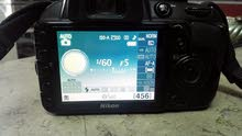 كاميرا احترافيةماركة نيكون Nikon D3100 مع عدستها الاتوماتيك الاصلية