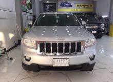 Silver Jeep Laredo 2013 for sale
