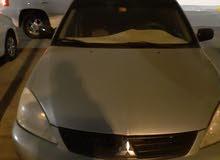 ميتسوبيشي لانسر 2010للبيع السعر  10000