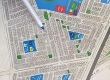 للبيع نص أرض في حي الزمرد
